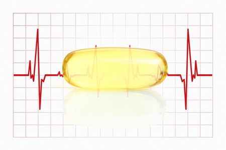 yellow fish oil capsule and electrocardiogram Stock Photo - 16486425