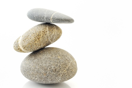 work life balance: Pyramid of stones over white. Stock Photo
