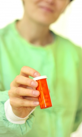 doctor holding bottle of prescription pills Stock Photo - 16480197