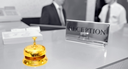 luxury hotel room: bell on hotel reception