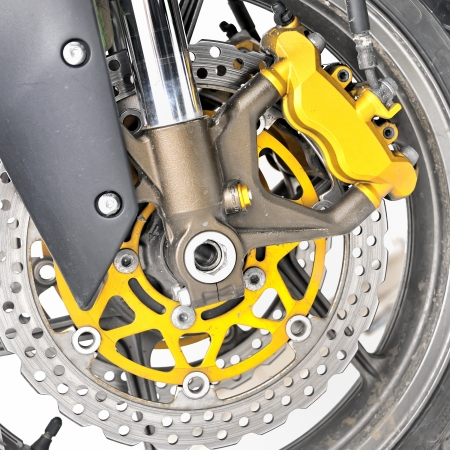 Closeup detail of a motorcycle's front wheel Stock Photo - 16483335