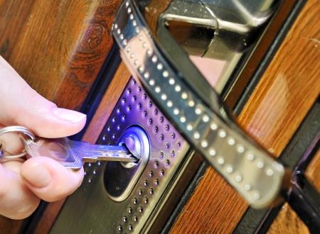 locks: open door with key Stock Photo