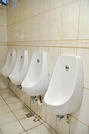 Man�s toilet interior  Stock Photo