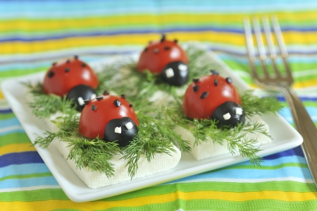 ladybug tomato and olive with cheese photo