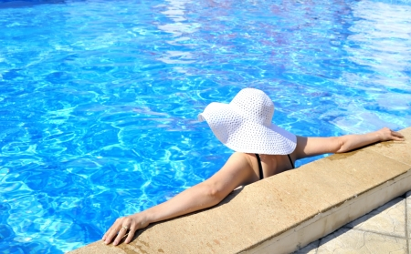 Woman in a pool relaxing photo