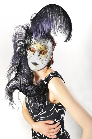 girl in a Venetian mask isolated photo