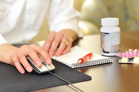 A female doctor making a a prescription