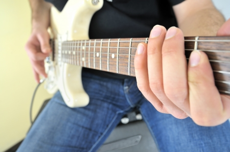 Young with guitar and an amplifier Stock Photo - 16527202