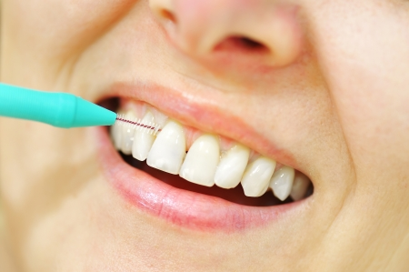Girl with Interdental Brushes