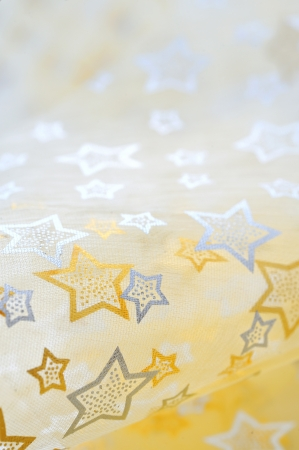 Golden stars on cloth background Stock Photo - 16567471
