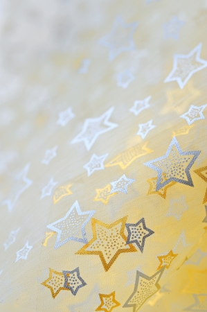 happening: Golden  stars on cloth  background