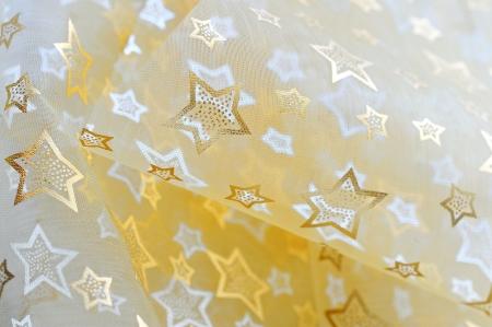 Golden stars on cloth background Stock Photo - 16567603