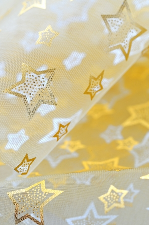 Golden stars on cloth background Stock Photo - 16567604