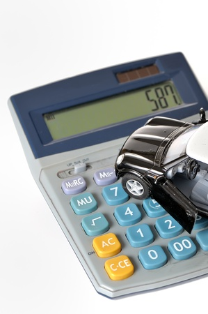 Calculator and toy car Stock Photo - 16822790