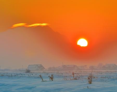 sunset over village Stock Photo - 17456898