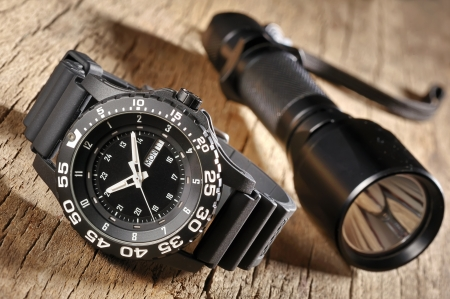 military watch and flashlight Stock Photo - 17931845