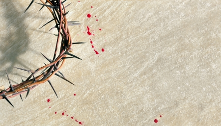 Crown of thorns with blood on grungy background photo