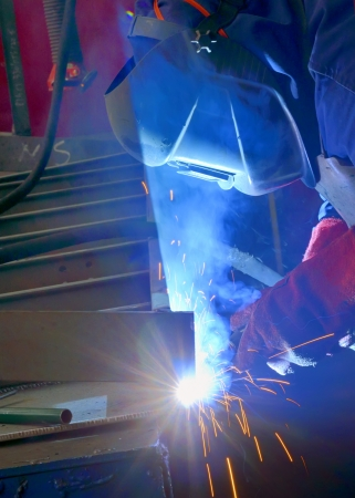 welder with protective mask welding metal and sparks Stock Photo - 18116379