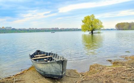 danube delta: boat on shore of danube