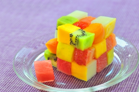 cube fruits salad on lilac background Stock Photo - 18385604
