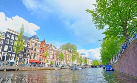 westerkerk: Traditional Houses and house boat along canal in Amsterdam, Holland Editorial