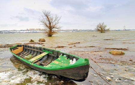 green boat: green boat on danube river in winter Stock Photo