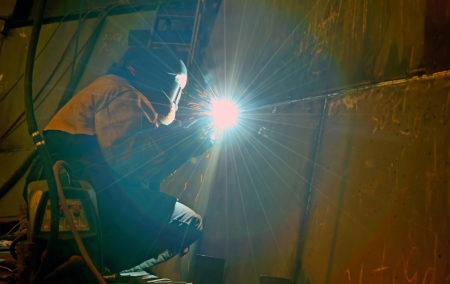welding with mig-mag method inside of shipyard Stock Photo - 18841872