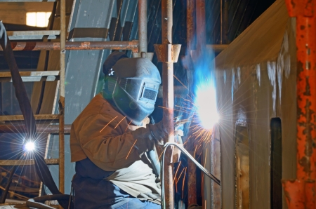 a welder working at shipyard in day time Stock Photo - 18841887