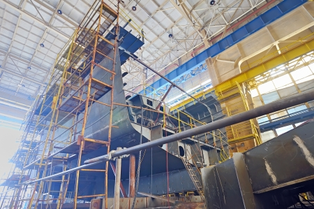 hull: Ship building shoot  inside of shipyard Stock Photo