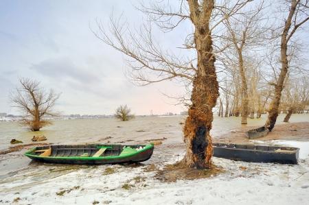 green boat on danube river in winter Stock Photo - 18992393