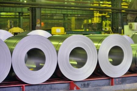 rolls of steel sheet in a warehouse photo