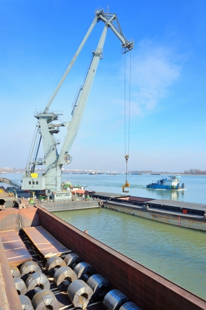crane and steel plate loading  in harbor photo