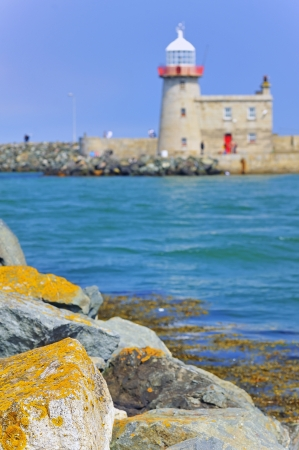 LIGHTHOUSE AT HOWTH HARBOR IN IRELAND Stock Photo - 19715273
