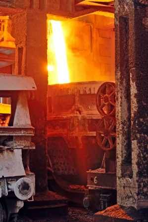 Molten hot steel pouring in plant photo