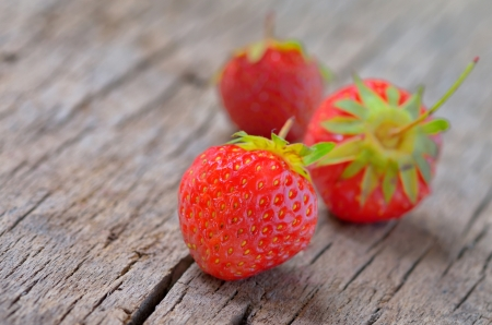 Fresh strawberries on old wooden background Stock Photo - 19986207
