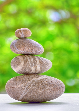 Stack of four stones isolated. stones in balanced pile Stock Photo - 20324591