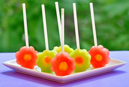 fruit pops of melon and watermelon on natural background Stock Photo - 20332160