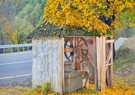 Countrry Old Well in autumn time Stock Photo - 20764436