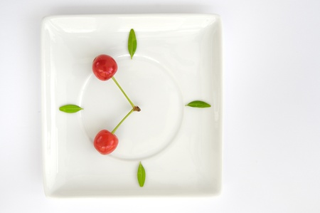cherry fruit  clock isolated on plate Stock Photo - 20764490