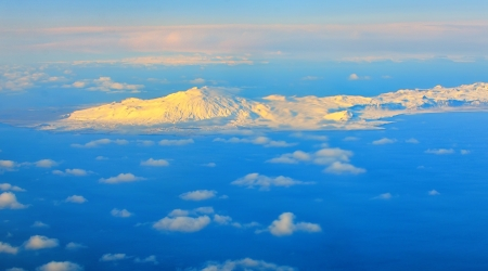 aerial view of mountains and clouds on top at sunrise Stock Photo - 21451593