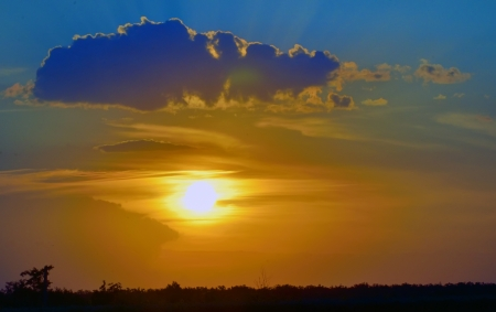 beautiful sunset above green filed in summer time Stock Photo - 21451698