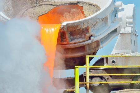 ferrous foundry: The molten slag is poured from a cup on a railway platform