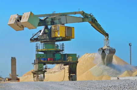 Heavy excavator loader at soil moving works at construction  photo