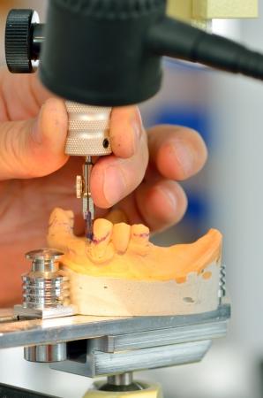 Dental technician measuring dentures in laboratory Stock Photo - 21452252