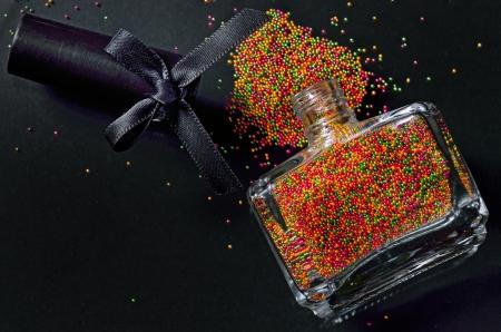 Bottle with colorful nail polish on black background Stock Photo - 21452002
