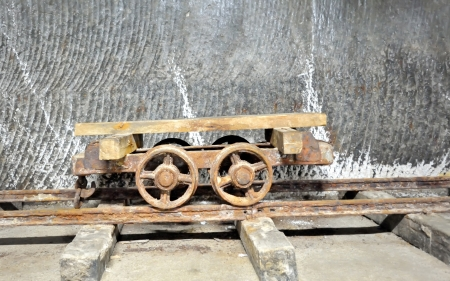 old  wagon inside of salt mine on rail Stock Photo - 21452095