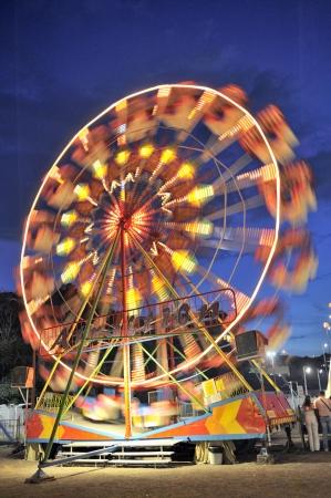merry go round: Ferris wheel in a summer night in Nessebar Editorial