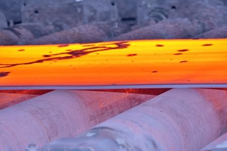 hot steel on conveyor, macro