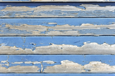 Background made from weathered boards of exfoliated wood  photo