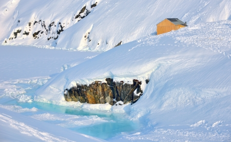 House on glacier in Greenland in spring time Stock Photo - 21885623